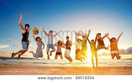 Group of friends jumping on beach, concept fun jump