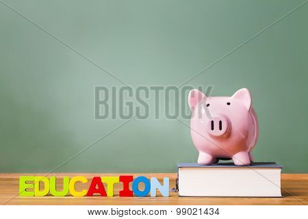 Education Theme With Textbooks And Piggy Bank