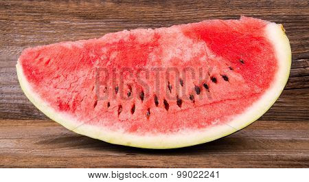 Slices Of Watermelon On Old Wooden Background