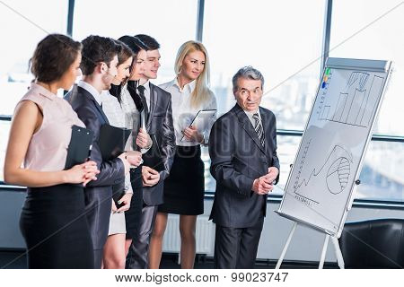 A Group Of Businessmen Discussing The Policy Of The Company