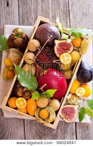 Exotic fruits in a wooden crate