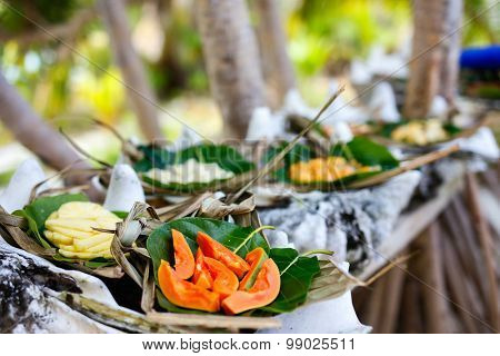 Close up of some local south pacific origin food served in giant shells