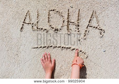 ALOHA word written on tropical sand beach