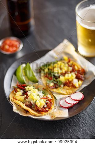 authentic al pastor street tacos with pineapple and beer