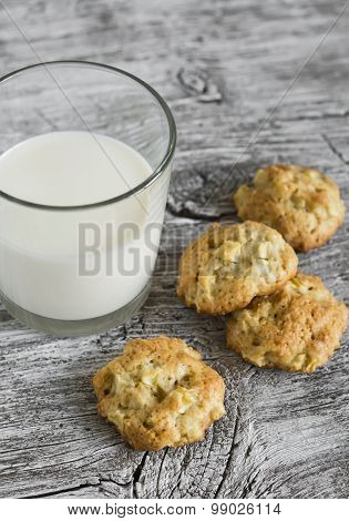 Oatmeal Cookies With Apples And A Glass Of Milk On A Light Wooden Surface