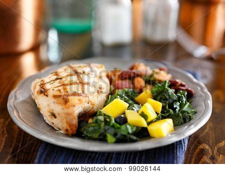 grilled chicken with mango kale salad