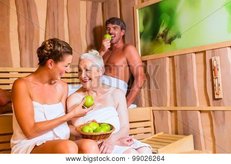 Senior woman and couple sweating in sauna