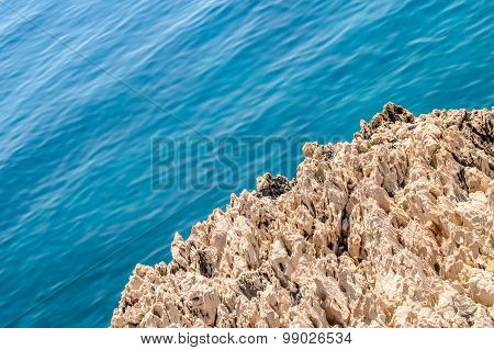 A Rough Rock On The Coastline Of Clean Blue Adriatic Sea