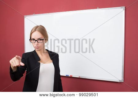 Business woman pushing on a touch screen interface
