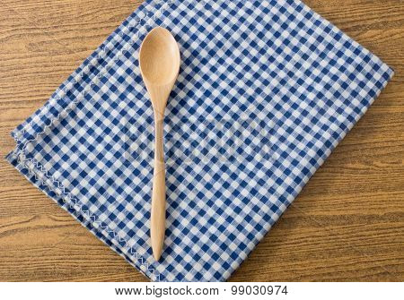 Wooden Spoon On Blue And White Checked Napkin