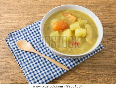 Bowl Of Curry Soup With Potato And Tomato