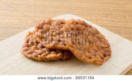 Close Up Thai Snack Peanut Cracker On Wooden Board
