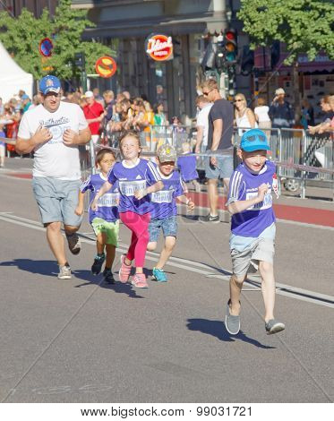Four Happy Kids And Father Running