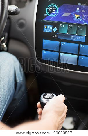 transport, destination, modern technology and people concept - male hand on gearshift and navigation system on car dashboard screen