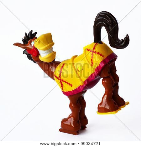 Leaping colorful donkey toy on the white background