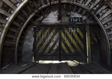 Gate In Underground Illuminated Tunnel