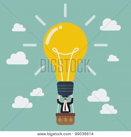 Businessman Celebrating In Lightbulb Balloon