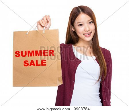 Asian woman take shopping bag and showing summer sale