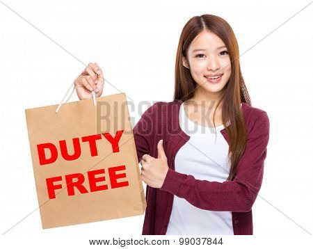 Young Woman hold with shopping bag and thumb up for showing duty free