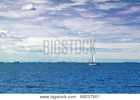 Sailing Boat On Open Blue Sea