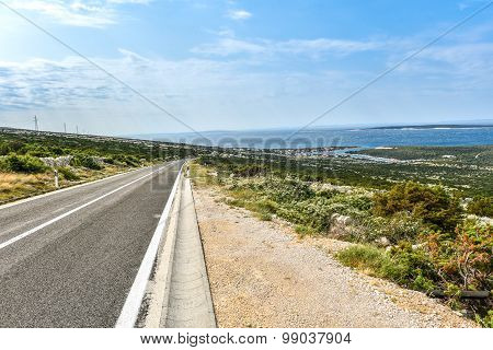 Open Road Leading To The Sea