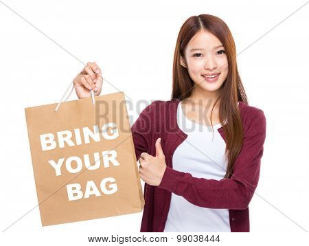 Young Woman hold with shopping bag and thumb up for showing bring your bag