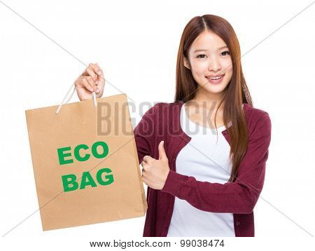 Young Woman hold with shopping bag and thumb up for showing eco bag