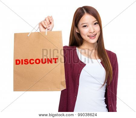 Asian woman take shopping bag and showing a word discount