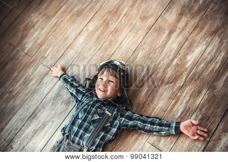 Laughing boy on the floor