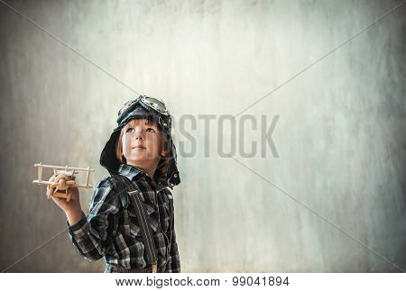 Little boy with airplane in the studio