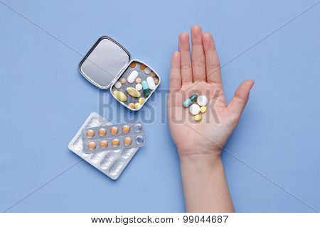 Pills And Medicine Capsule In Hand