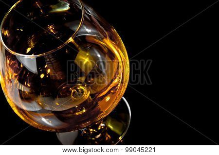 Snifter Of Brandy In Elegant Typical Cognac Glass On Black Background