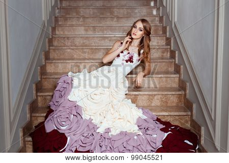 Girl In A Ball Gown Lying On The Steps.