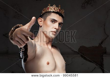 Young Man With Crown On The Head Pointing Her Finger.