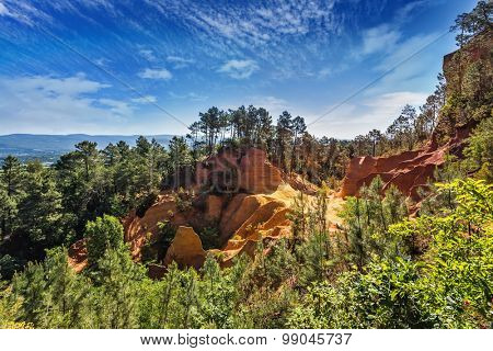 Picturesque pit of production of ochre - natural paint. Roussillon, Red village of Provence