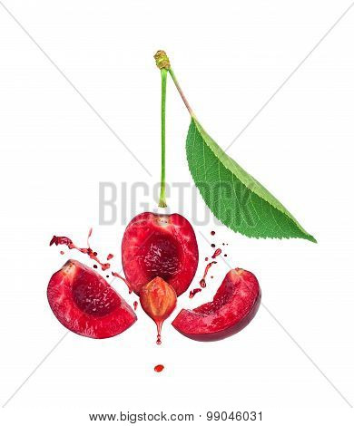 The Explosion Of Cherries For Three Slices And A Splash Of Cherry Juice Isolated On White Background