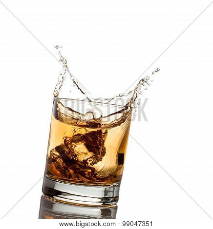 whisky splash isolated on a white background