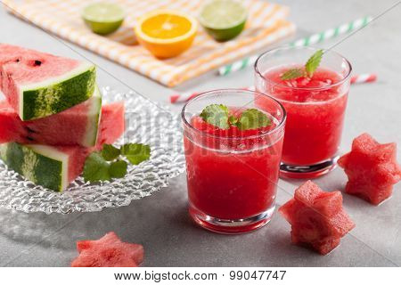 Glasses Of Watermelon Juice With Ice And Watermelon Figurines