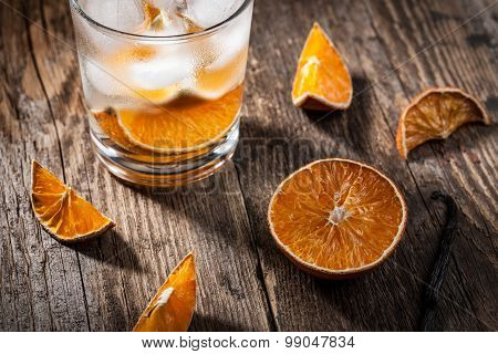 Glass Of Water With Ice Cubes And Dried Orange