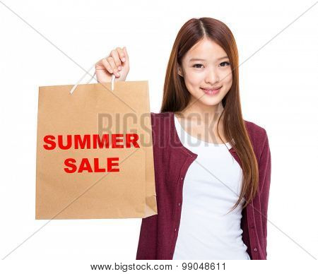 Woman hold with shopping bag and showing summer sale