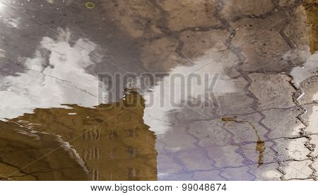 Building In Puddle Of Water Reflection