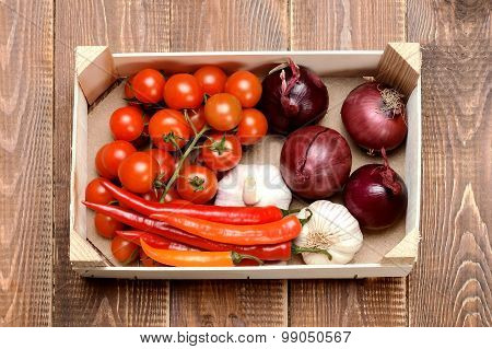Assorted Vegetables In A Wooden Crate On A Wooden Background.