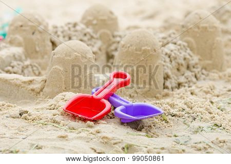 Sand Castle And The Shovels And Rake