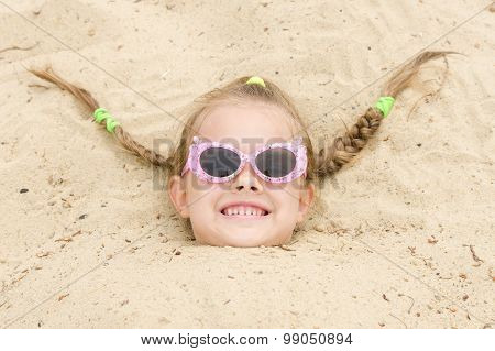 Five-year Girl Fell Asleep On His Head In The Sand