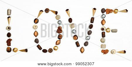 Word Love Made Of Little Chocolates In Shape Of Letters And Heart