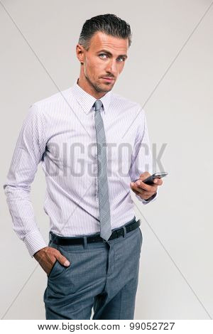 Portrait of a handsome businessman using smartphone isolated on a white background