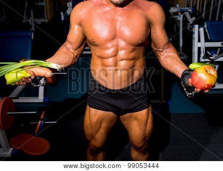 Bodybuilder Holding Vegetables