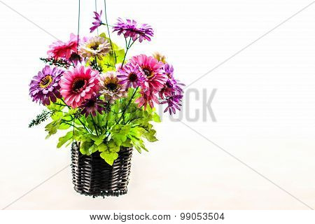 Artificial Flowers In Vase Hanging On White