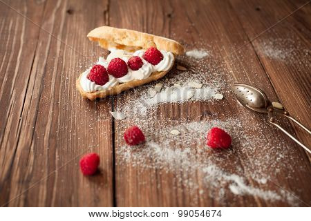 Eclair With Fresh Raspberries On Wood Table, Confectioner Table