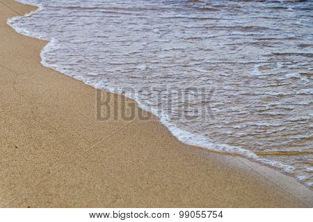 Sea Wave Motion On Smooth Sandy Beach, Diagonal View With Selective Focus